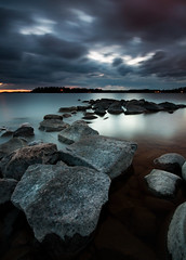 Nicely lined up (- David Olsson -) Tags: longexposure lake seascape nature water clouds landscape evening nikon rocks cloudy sweden dusk stones sigma filter le april late 1020mm grad 1020 hitech vänern darkclouds rainclouds 2012 darksky dx hammarö värmland aftersunset gnd smoothwater skoghall d5000 hintoforange mörudden davidolsson 09hard