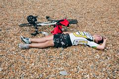 Sleepy cyclist #4 (lomokev) Tags: sleeping portrait england man male beach bike sport canon private person eos brighton cyclist unitedkingdom stones sleep human 5d exhausted londontobrighton sleeeping canoneos5d shotonhscourse londontobrighton2012 file:name=120617eos5d9065