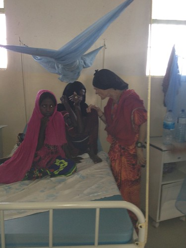 Malika with mother and child who had emergency operation after failing to pass urine due to FGM