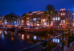 Night Lights on the Amsterdam Canals (Jenny Rainbow) Tags: lighting street city longexposure trip travel bridge blue windows light house holland building travelling tourism water netherlands beautiful dutch amsterdam architecture night reflections dark spectacular boats boat town canal nikon darkness nederland landmark scene journey lanterns romantic channel romanticnight sigma2470mmf28 dutcharchitecture d700 jennyrainbowfineartphotography jennyrainbowtravelphotography romanticnightatamsterdamcanals mostbeautifulcitiesoftheworld