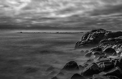 A Mugu Point Of View 2 (Wilkof Photography) Tags: ocean california ca longexposure light shadow sea sky blackandwhite bw seascape abstract motion reflection beach nature wet water overgrown silhouette rock skyline architecture 35mm canon lens landscape outside coast countryside seaside rocks surf waves cityscape afternoon waterfront natural cloudy cove tide horizon perspective scenic rocky windy overcast landmark malibu boulders pacificocean socal le nd land southerncalifornia hazy hillside polarizer volcanic iconic cloudcover beachfront cpl pacificcoasthighway pointmugu oceanfront topography oceanscape neutraldensity 18135mm 10stop nd1000 canont4i wilkofphotography