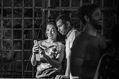Mixed feelings - snapshot [explored] (kurjuz) Tags: argottigardens ghanafest2016 blackandwhite couple expressions humour portrait selfie streetphoto