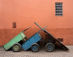 One, two, three Marlenas.. (areyarey) Tags: life africa street old city travel pink window wall wagon three trolley wheels scene morocco marrakech medina marrakesh cart ochre carts mdina areyarey superaplus aplusphoto