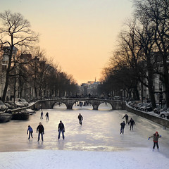 Ice skating season in Amsterdam (Bn) Tags: winter sunset people orange cold holland ice netherlands dutch amsterdam geotagged frozen zonsondergang topf50 downtown iceskating skating joy kinderen nederland freezing first canals age skate anton temperature topf100 mokum occasion rare grachten pleasure skates blades winters stad harsh keizersgracht jordaan 2012 westertoren d66 ijs gluhwein schaatsen koud amsterdamse ijspret hendrick bruegel chocolademelk meester grachtengordel hollandse oudhollands 100faves 50faves natuurijs pieck gekte winterse sferen geo:lat=52373392 avercamp ijzers ijsplezier jordanezen ijsnota geo:lon=4884973