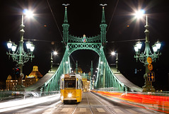 Budapest Liberty Bridge - Szabadsg hd (Crazy Ivory) Tags: street longexposure bridge red sky white black green cars car yellow night canon dark interesting long exposure hungary darkness cross streetlamps hill budapest tram lamps duna streetcar tramway ungarn danube strassenbahn gellert donau lightstreams 24105 libertybridge szabadsghd canon24105 40d canoneos40d canonef24105mm140lisusm