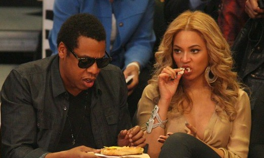 Jay-Z and BEYONCE share some food at the NBA All-Star Game in LA
