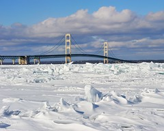 """Icy Straits""  Winter at Mackinac Bridge, Mackinaw City, Michigan (Michigan Nut) Tags: winter sky usa snow cold ice nature clouds photography frozen midwest michigan mackinacbridge drifting mackinawcity johnmccormick michigannutphotography"