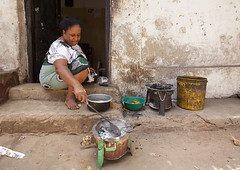 Woman Cooking In The Street, Lamu, Kenya (Eric Lafforgue) Tags: poverty africa street food color cooking horizontal outside island photography sitting kenya culture unescoworldheritagesite boutique afrika tradition lamu swahili afrique eastafrica qunia lamuisland lafforgue traveldestination africanethnicity kenyaafrica muslimislam  qunia    kea 123871 exterioroutdoors   tradingroute blackethnicity a streetvendorseller midadultmidadults