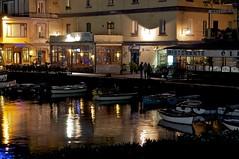 per le vie del borgo urla e biancheggia il mare (Crimilde_) Tags: reflections lights barche napoli naples luci riflessi borgo megaride borgomarinari