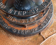 Step Up (Peter E. Lee) Tags: winter black concrete hawaii rust message unitedstates oahu letters rings telescope castiron hi base concentric 2012 stepup pedestal doleplantation wahiawa