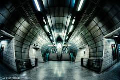 Futurism (Aaron Yeoman [Old Account]) Tags: city uk greatbritain travel blue england urban london lines station metal architecture modern underground subway europe metro unitedkingdom sony perspective railway tunnel line fisheye gb docklands tubestation londonunderground subwaystation alpha vignetting vignette hdr highdynamicrange southwark thetube metrostation tfl lul theunderground undergroundstation rapidtransit southeastlondon a700 fluorescentlamp metropolitanrailway fluorescentlamps southwarktubestation southwarkundergroundstation sonyalpha700 dslra700 samyang8mmf35mcfisheye