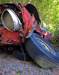 McLean's_0045 (janetliz) Tags: old cars rusty tire headlight scrapyard decayed tpmg autowreckers mcleans