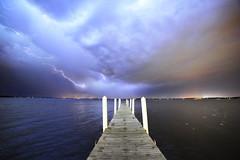First Light on the Pier (Kirby Wright) Tags: county blue sky cloud lake hail wisconsin night clouds pier cg nikon memorial long exposure shot union ducks madison strike dane lightning mendota f28 core universityofwisconsinmadison 14mm rokinon madison365 d700