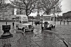 Wet day on the Dock. (f22photographie) Tags: blackandwhite wet rain liverpool rainyday citylife cobblestones icecream albertdock icecreamvan wetday albertdockliverpool vintagevans summilux24mmf14lens