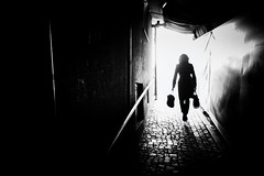 out of the darkness (Sandy...J) Tags: street city light shadow urban bw sunlight white black silhouette backlight germany dark walking bayern deutschland photography mono licht blackwhite women noir alone fotografie darkness walk sony streetphotography atmosphere cobblestones stadt sw monochrom frau passage atmosphre stimmung augsburg bavarian gehen gegenlicht dunkelheit kopfsteinpflaster allein sonnenlicht schwarzweis strase rx100 strasenfotografie