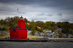 Big Red and the beach houses (Notkalvin) Tags: lighthouse cold holland beach water clouds pier cloudy outdoor michigan windy lakemichigan shore coolclouds hollandharbor hollandharborlight mikekline notkalvin notkalvinphotography