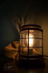 Cozy (Drifton) Tags: light black bulb bronze night dark cozy warm glow background rustic warmth surreal edison burlap