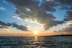 Sun Meets Coast (Vilim Hlusicka) Tags: blue sunset sea vacation sky sun beach nature yellow clouds evening coast seaside nikon holidays dramatic croatia sigma romantic zadar adriatic 1835 zaton
