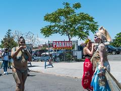 Is This the Same Woman? Mermaid Parade (UrbanphotoZ) Tags: nyc newyorkcity woman shells ny newyork geometric glitter brooklyn coneyisland beads eating parking skirt bodypaint turtles topless octopus cubes mermaid mermaidparade headpiece coneyislandmermaidparade interconnected stphotographia