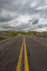 Road Trip (s.d.sea) Tags: road park sky terrain nature grass clouds landscape outdoors spring moody pentax cloudy hiking path south national badlands dakota