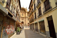 Shopping street with closed shutters with the Cathedral de Granada in the background [Granada / Spain] (babakotoeu) Tags: spain granada shutters cathdral