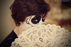 Hiding (MalloryWilliams) Tags: girl dayofthedead skull 50mm fan lace makeup diadelosmuertos shorthair facepaint lacefan skullmakeup facemakeup