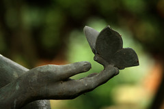 Butterfly bokeh (gwiwer) Tags: friedhof cemetery grave statue butterfly germany deutschland bokeh tomb tombstone hamburg grab ohlsdorf schmetterling cimetière parkfriedhof