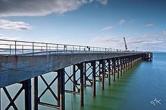cockenzie pier (Mike Clark 100) Tags: blue seascape reflection green sunshine scotland pier east lothian cockenzie