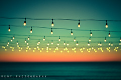 bokeh :: sunset (reny :: honey) Tags: ocean sunset sea water canon lights bokeh lightbulbs 85mm 5d hbw