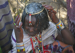 Butter shampoo during Gada ceremony in Karrayyu tribe - Ethiopia (Eric Lafforgue) Tags: haircut girl beauty culture tribal butter tribes tradition tribe ethnic hairstyle tribo ethnology tribu thiopien etiopia ethiopie etiopa oromia oromo 9159  etiopija borana ethnie ethiopi  etiopien etipia  etiyopya          kereyu karrayyu karrayu kararyu karrayuborana