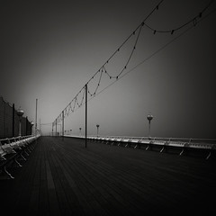 Boardwalk (Andy Brown (mrbuk1)) Tags: mist lines fog contrast dark mono pier vanishingpoint blackwhite moody chairs grain perspective minimal devon rows seats promenade repetition benches torquay lowkey planks atmospheric timbers diagonals betyoudontseethesewords