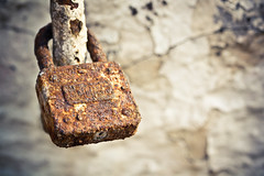 Padlocked {Explored} (Grace5mith) Tags: old ireland house macro abandoned home window metal stone wall closeup canon vintage wire rust key lock letters chain explore string northernireland 60mm padlock derelict portrush fob explored i500 canon600d cararosepresets interestingness216010412