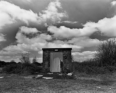 Greenham Common Negative Scan Electrical Outbuilding (Rebecca Sharplin Hughes) Tags: white black abandoned mamiya film field army infrared medium format common derelict newbury nato airfield rb67 greenham film:iso=400 developer:brand=agfa film:brand=rollei agfar09oneshot developer:name=agfar09oneshot rolleiinfraredir film:name=rolleiinfraredir400 filmdev:recipe=8414