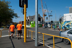 Afternoon Tea (Jocey K) Tags: road street trees newzealand christchurch sky people building art cars church architecture mural shadows cranes nz rebuild hivis stareetart knoxchurchrebuild