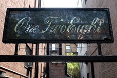 One Two Eight (pburka) Tags: nyc two glass sign typography one iron manhattan communication number ues script eight address flourish 128 e91st