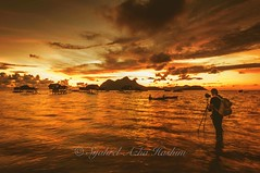 Photographing a photographer photographing... (Syahrel Azha Hashim) Tags: ocean travel light vacation portrait holiday detail nature beautiful clouds sunrise island nikon colorful dof getaway horizon naturallight tokina portraiture malaysia handheld shallow woodenboat simple dramaticsky sabah ultrawideangle colorimage semporna housesonstilts d300s maigaisland syahrel