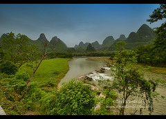 Limestone mountain scenery on the Li River at Xingping, Guangxi Autonomous Region, China (jitenshaman) Tags: china travel mountains reflection nature water river landscape asian liriver li boat scenery asia guilin yangshuo chinese bamboo limestone destination raft peaks karst guangxi xingping worldlocations