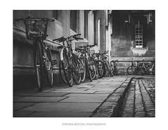 Bikes (Stephen Weston Photography) Tags: road street old light urban white black building brick monochrome stone architecture night vintage buildings landscape photography mono photo blackwhite fuji shot pics outdoor bikes images stephen cobblestones walkway oxford bleak fujifilm weston x20 lightroom 2016 stephenwestonphotography