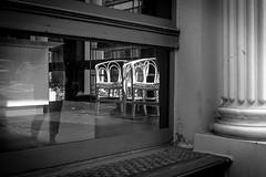 arm chair pair (Anna Afanaseva) Tags: nyc light blackandwhite streets reflection monochrome manhattan streetphotography pillars throughthewindow