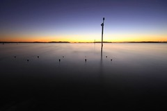 Smooth (pominoz) Tags: reflection sunrise pole nsw portstephens swanbay