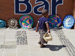Bar boy (D70) Tags: boy bar mexico cabo san walks basket with young lucas plates baja past cabosanlucas decorated brightly bajamexico