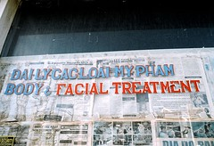 Facial Treatment (Georgie_grrl) Tags: toronto ontario window newspapers photographers social daily storefront pentaxk1000 outing translationplease cans2s rikenon12828mm torontophotowalks topwci2 corsoitaliaversion20 bodyfacialtreatment