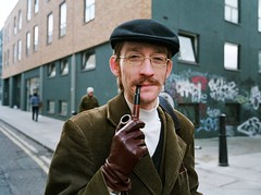 Oh I say...... (deepstoat) Tags: street portrait london leather 28mm pipe smoking moustache gloves smoker beret corduroy thelook contaxg2 pipesmoker fujipro400h
