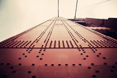 Bumpy (Leighton Wallis) Tags: sanfrancisco california birthday ca red usa tower suspension unitedstatesofamerica north goldengatebridge cables bumps rivet internationalorange 75thanniversary ggnpc11