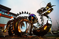 Dragon at Twilight (TOTORORO.RORO) Tags: sculpture canada color reflection art vancouver ball lens hotel mirror twilight dragon bc britishcolumbia steel sony happiness casino richmond resort translucent alpha fortunes f28 hdr slt ssm stainless riverrock greatervancouver a55 yearofthedragon kevinstone 1650mm imperialwaterdragon sal1650 surgicalgrade