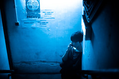 XXX (TGKW) Tags: blue light portrait people girl mobile night standing phone candid chinese cell stairwell nightclub hong kong posters nightlife xxx wan talking sheung 6113