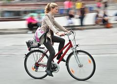 Frankfurt 2010 (jeremyhughes) Tags: city urban woman motion bike bicycle female speed germany deutschland cycling movement nikon cyclist frankfurt commuter elegant nikkor panning vr frankfurtammain 18200mm redbike d40 cyclechic velocouture
