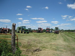 Mike Dodd - Neighbors Helping Neighbors (Missouri Agriculture) Tags: red green field farmers farm farming mo equipment pasture missouri ag hay agriculture bales tractors neighbors johndeere farmequipment caseih moag missouriag