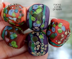 Rocks Coral Grapes (Laura Blanck Openstudio) Tags: show blue red etched orange usa abstract brick green art glass coral festival set beads sand beige rocks colorful aqua published artist glow purple handmade stones eggplant teal maroon fine arts violet plum sienna funky jewelry pebbles made odd earthy mango winner mauve opaque bead mermaid nuggets murano grape lampwork multicolor raku artisan matte whimsical loose frit openstudio asymmetric ocher speckles openstudiobeads