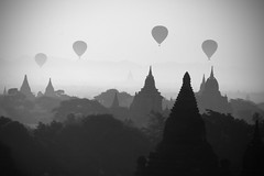 Chase Your Dream Across the Sky (cormend) Tags: morning travel trees blackandwhite bw mist silhouette fog sunrise canon landscape temple eos dawn pagoda asia tour burma buddhist balloon tourist myanmar southeast bagan upupandaway birmanie fifthdimension 50d cormend mybeautifulballoon